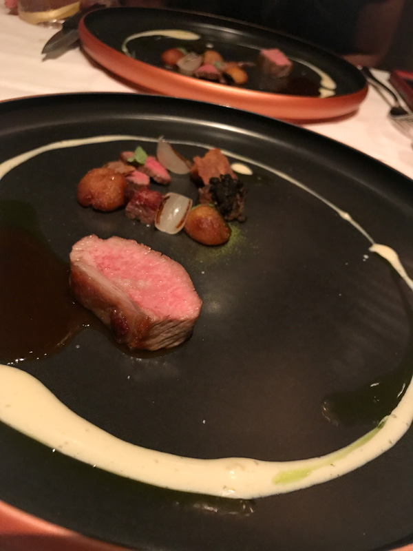 Milk Fed Lamb with Potato, Nepitella, and Black Garlic at Quince